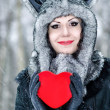Valentine's Day. Beautiful smiling woman with red heart in her hands — Stock Photo