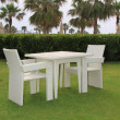 Stok fotoğraf: Two chairs and pure table on green lawn
