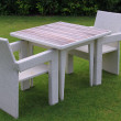 图库照片: Two chairs and pure table on green lawn