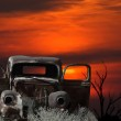 Montage of an old car and sunset — Stock Photo