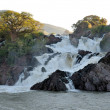 Epupa waterfalls on the border of Angola and Namibia - Stock Photo