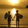 Silhouettes of two children playing on the beach — Stock Photo