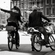 Man and woman on the bikes, Amsterdam — Stock Photo