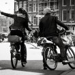 Man and woman on the bikes, Amsterdam - Stock Photo