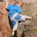 Boy Toddler Climbing a Rock — Stock Photo #38362457