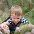 Boy Climbing up Boulder — Stock Photo #38362627
