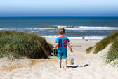 Boy walking towards beach — Stock Photo