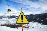 Yellow Warning Sign on Ski Slope — Stock Photo