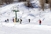 Group of Skiers using Drag Ski Lift — Stock Photo