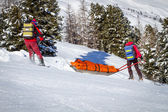 Ski Patrol Helping Injured Skier — Stock Photo