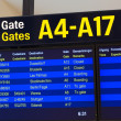 Departure board at airport — Stock Photo