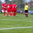 Soccer players and referee — Stock Photo