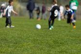 Kids playing soccer — Stock Photo