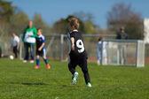 Boy playing soccer — Стоковое фото