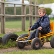 Young boy driving buggy cart — Stock Photo