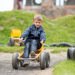 Caucasian boy driving buggy cart — Stock Photo