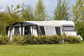 Caravan and camping tent — Stock Photo
