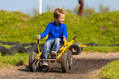 Boy maneuvering pedal go cart — Stock Photo