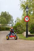 Boy driving pedal go cart — Stock Photo