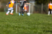 Blurred soccer kids — Stock Photo