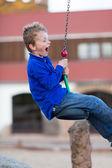 Boy on flying fox — Stock Photo