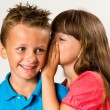 Young girl telling secret to young boy — Stock Photo #48073891