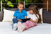 Kids sharing a tablet — Stock Photo