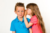 Girl whispering to boy — Stock Photo
