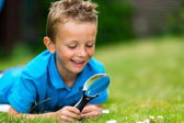 Boy with magnifier — Stock Photo