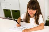 Garota escrever o alfabeto abc — Fotografia Stock