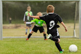 Kids soccer penalty kick — Stock Photo