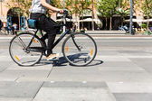 Bicycle in city traffic — Stock Photo