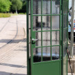 Old green phone booth — Stock Photo #50315089