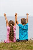 Kids with raised arms — Stock Photo