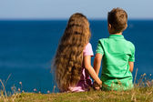 Boy and girl during summer time — Stock Photo