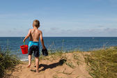 Boy with beach toys — Stock Photo