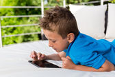 Young boy with a tablet — Stock Photo