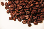 Brown coffee beans isolated on white background — 图库照片