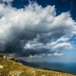 Cloud over a cliff - Stock Photo
