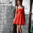The girl in the red dress — Stockfoto