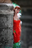 The girl in the red dress — Stock Photo