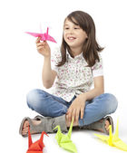 Cute girl with origami birds — Stock Photo