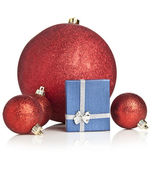 Red Christmas gift box and baubles — Stock Photo