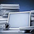 Laptop and Business newspaper — Stock Photo #23513873