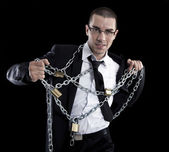 Businessman tied with chains — Stock Photo