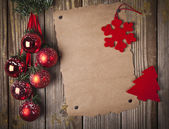 Blank grunge paper over wooden background and christmas ornament — Stock Photo