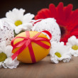 Yellow easter egg with flowers - Stock Photo
