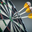 Three darts in the target center — Stock Photo #51163081