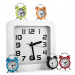 White wall clock and several alarm clock — Stock Photo #51163659