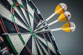 Three darts in the target center — Stock Photo